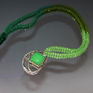 Silver medallion with Chrysoprase and necklace made of three shades of green glass crystal beads