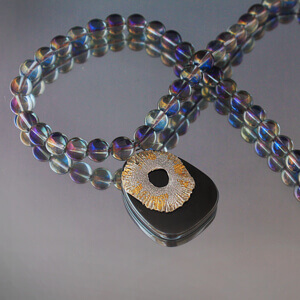 Rainbow crystal beads and medallion made of silver gold and Hematite