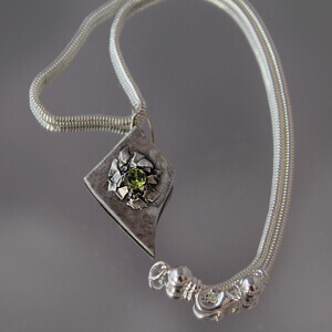 Silver and Peridot medallion and necklace